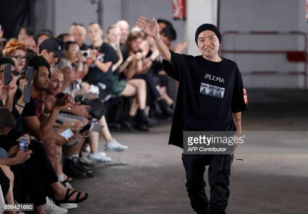 Japanese fashion designer Julius acknowledges the audience after the men's 2017/2018 Spring/ Summer collection fashion show on June 21 2017 in Paris...