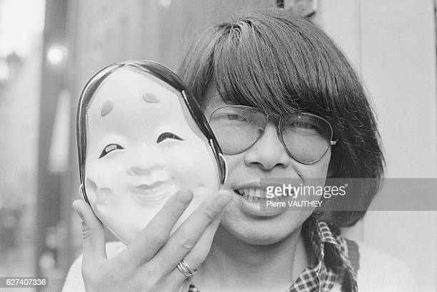 Japanese fashion designer Kenzo Takada holds a theatrical mask He created the designer fashion label Kenzo and retired in 1999