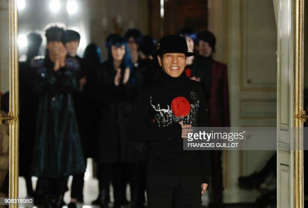 Japanese fashion designer Rynshu acknowledges the audience at the end of the Rynshu fashion show during men's Fall/Winter 2018/2019 fashion show in...