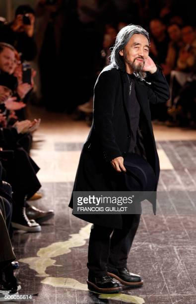 Japanese fashion designer Yohji Yamamoto acknowledges the crowd after his fashion show during men's Fashion Week for the 2016-2017 Fall/Winter...