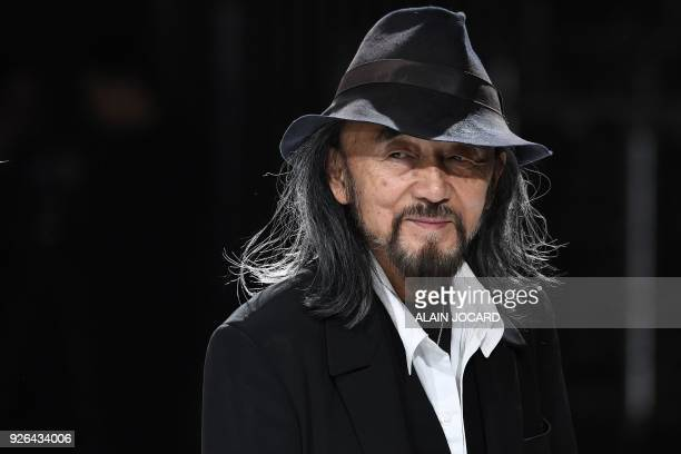 Japanese fashion designer Yohji Yamamoto looks on before his 2018/2019 fall/winter collection fashion show on March 2, 2018 in Paris.