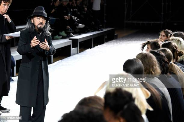Japanese fashion designer Yohji Yamamoto speaks with models ahead of his Yohji Yamamoto Spring-Summer 2019 Ready-to-Wear collection fashion show in...