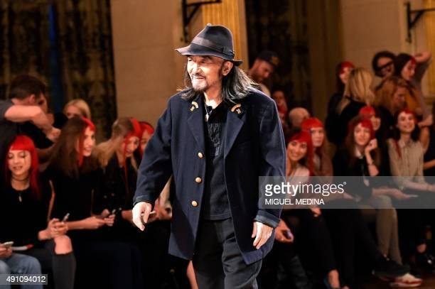 Japanese fashion designer Yohji Yamamoto walks next to models before his 2016 Spring/Summer ready-to-wear collection fashion show, on October 2, 2015...