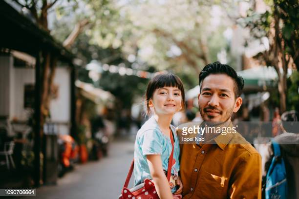 japanese father and his cute mixed race daughter - selective focus stock pictures, royalty-free photos & images