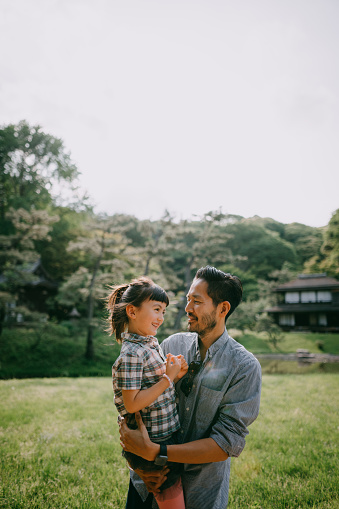 Japanese father and preschool mixed race daughter having intimate moment - gettyimageskorea