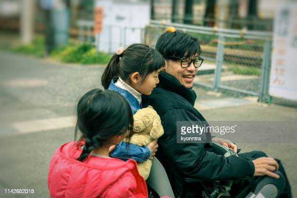 Japanese father on the wheelchair and Daughter