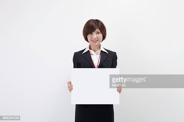 Japanese female company employee with a white board