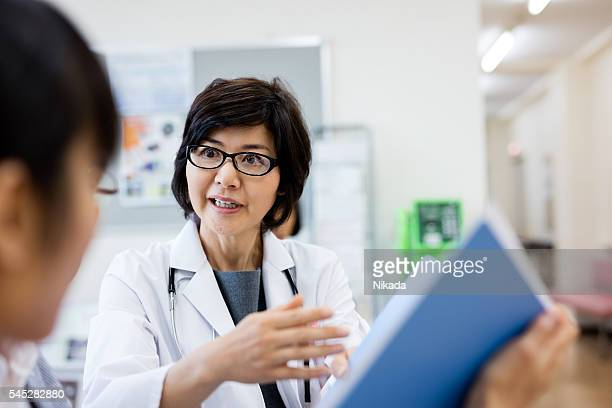 Japanese Female doctor talking to patient