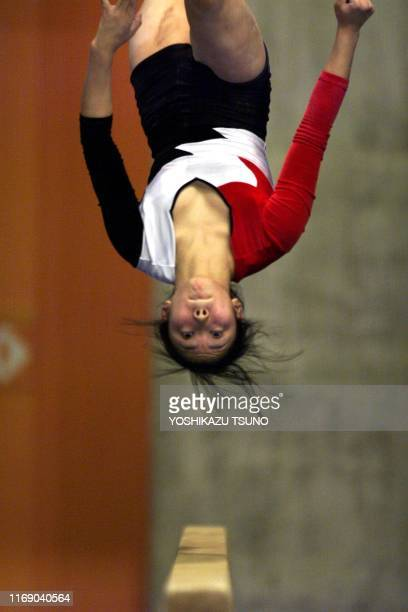 Japanese female gymnast Risa Sugawara flips over the beam during a training session for the 13th Asian Games at a gymnasium in Muang Tohong Thani in...