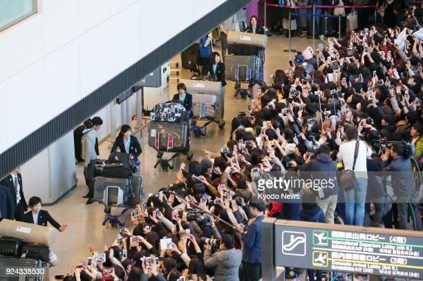 Japanese female speed skaters arrive at Narita airport near Tokyo to huge crowds on Feb 26 after winning six of Japan's 13 medals in the Pyeongchang...
