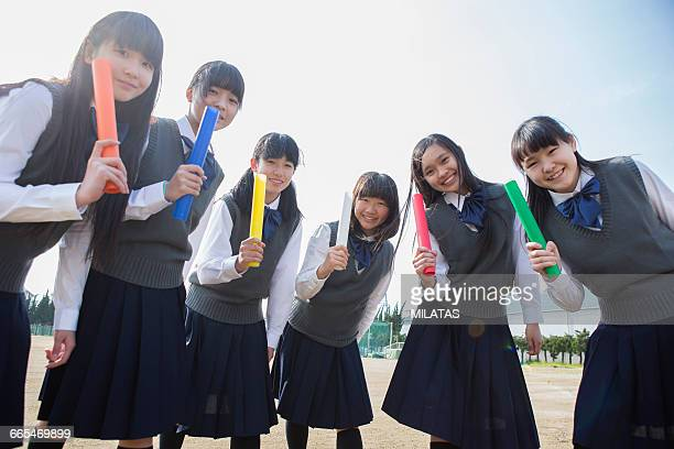 Japanese female student with a baton