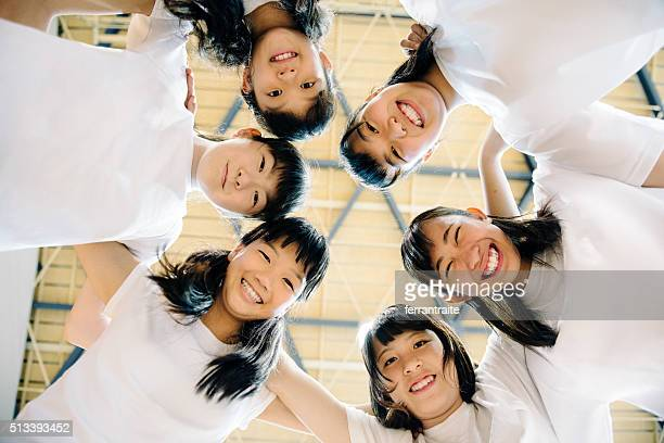 japanese female students teaming up - sports team event stock photos and pictures