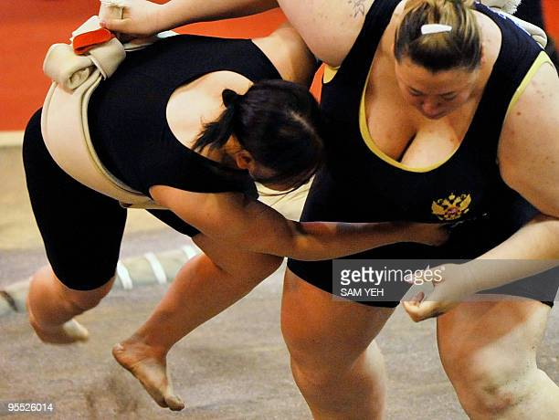 Japanese female sumo wrestler Tamami Iwai is lifted by Russia's Anna Alexsandrova during the World Games in Kaohsiung on July 18 2009 The World Games...