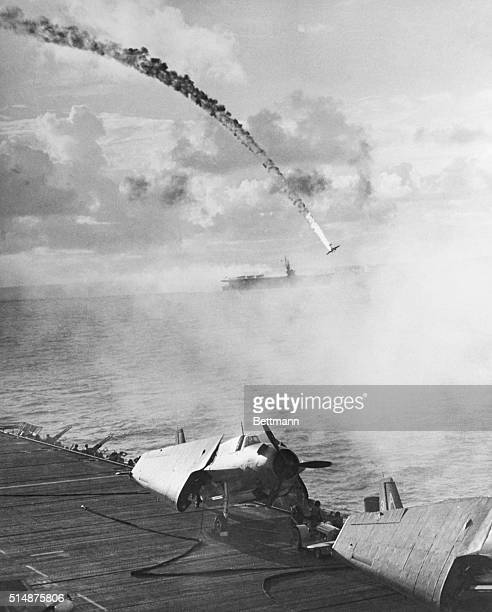 Japanese fighter plane on a kamikaze mission is shot down by anit-aircraft guns on an aircraft carrier. | Location: Near Saipan.
