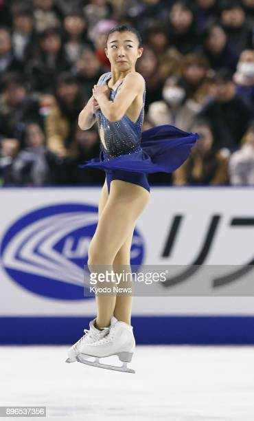 Japanese figure skater Kaori Sakamoto performs a jump en route to taking the lead after the women's short program at the national championships at...