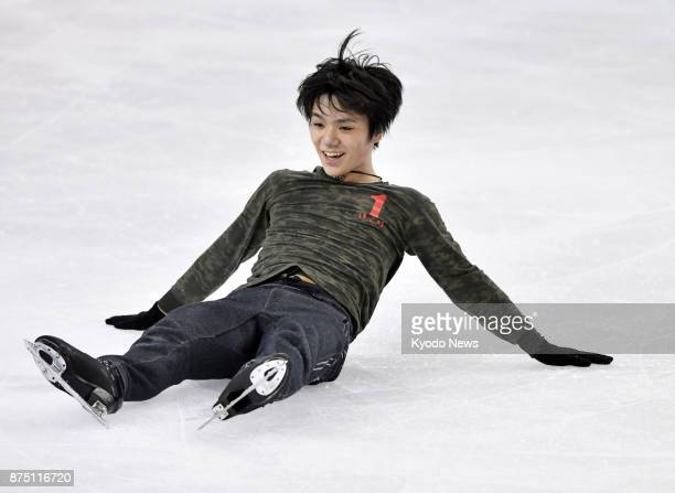 Japanese figure skater Shoma Uno falls after failing to land a jump during official practice in Grenoble France on Nov 16 for the Internationaux de...
