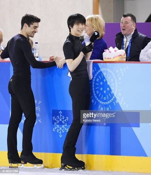 Japanese figure skater Yuzuru Hanyu chats with coach Brian Orser during official training in Gangneung South Korea on Feb 15 for the Pyeongchang...