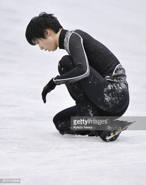 Japanese figure skater Yuzuru Hanyu falls in an attempt to land a quad lutz during training for the NHK Trophy in Osaka on Nov 9 2017 The 2014 Sochi...