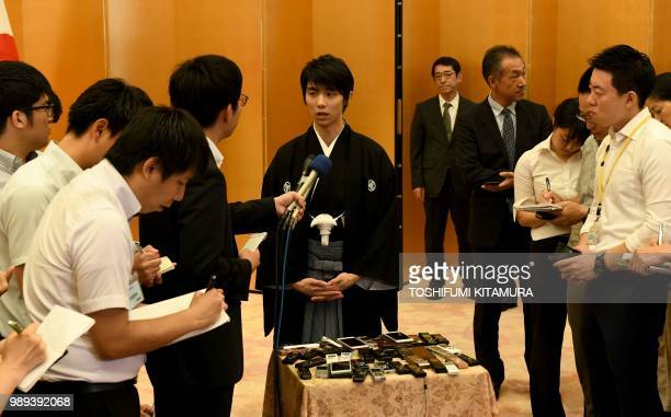 Japanese figure skater Yuzuru Hanyu receives a Q and A session with journalists following his People's Honor Award presentation ceremony at Japanese...