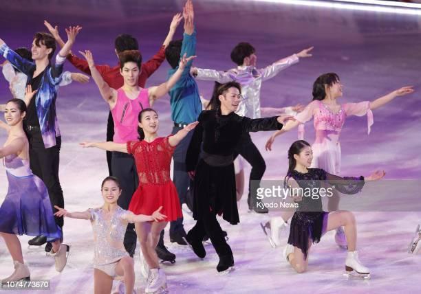 Japanese figure skaters, including Kaori Sakamoto and Daisuke Takahashi , perform during the exhibition gala of the national championships in Kadoma,...
