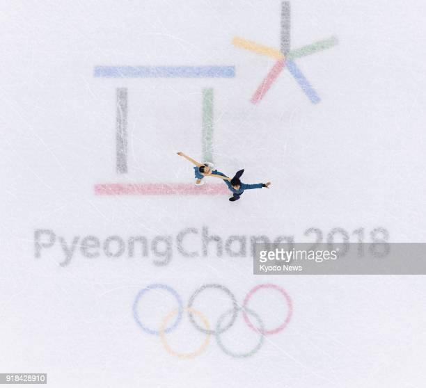Japanese figure skating pair Miu Suzaki and Ryuichi Kihara perform in the short program in Gangneung South Korea at the Pyeongchang Winter Olympics...