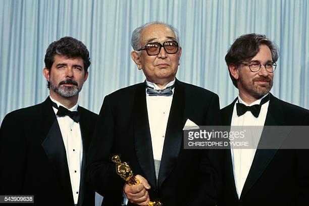 Japanese film director Akira Kurosawa with his Lifetime Achievement Oscar at the 62nd Academy Awards Ceremony With him are American directors Georges...