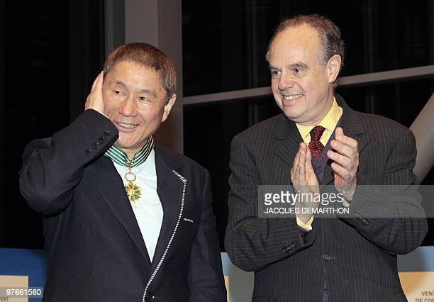 Japanese film director and artist Takeshi Kitano poses after being awarded Commander of the Order of Arts and Letters by French culture minister...