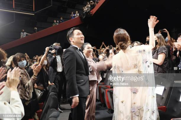 """Japanese film director Ryusuke Hamaguchi receives applause from the audience after the screening of his film """"Drive My Car"""" at the 74th Cannes Film..."""