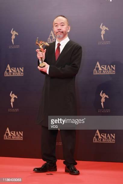 Japanese film director Shinya Tsukamoto poses backstage during the 13th Asian Film Awards on March 17 2019 in Hong Kong China