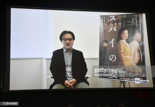 Japanese filmmaker Kiyoshi Kurosawa speaks in a video message from Japan after winning the best director award for Wife of a Spy at the 77th Venice...