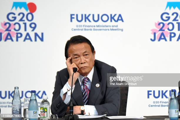 Japanese Finance Minister Taro Aso attends a press conference following the G20 Finance Ministers and Central Bank Governors meeting on June 09, 2019...