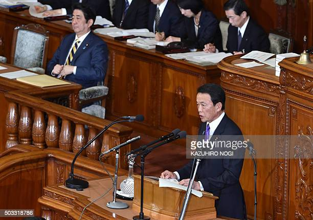 Japanese Finance Minister Taro Aso delivers a fiscal policy speech while Prime Minister Shinzo Abe attends the start of a 150day ordinary Diet...