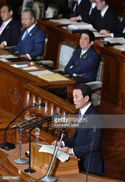 Japanese Finance Minister Taro Aso delivers a fiscal policy speech while Prime Minister Shinzo Abe and other ministers attend the start of a 150day...