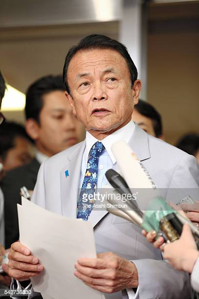 Japanese Finance Minister Taro Aso reads a statement after the UK has voted to leave the European Union on June 24 2016 in Tokyo Japan