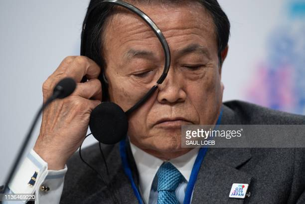 Japanese Finance Minister Taro Aso speaks during the G20 press conference during the IMF World Bank Spring Meetings at International Monetary Fund...