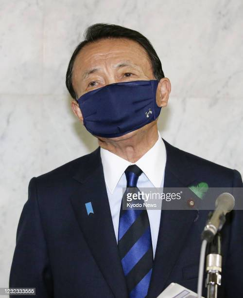 Japanese Finance Minister Taro Aso speaks to reporters after a Cabinet meeting in Tokyo on April 16, 2021.