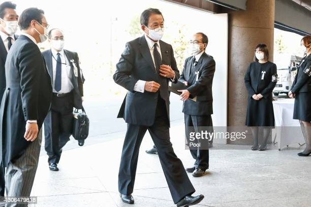 Japanese Finance Minister Taro Aso wearing a face mask arrives at the National Theatre of Japan to attend the national memorial service for the...