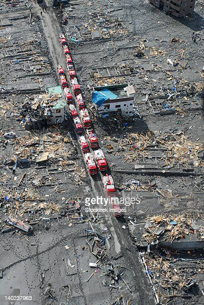 japanese fire trucks line a road in this aerial view of sukuiso, japan. - emergency management stock pictures, royalty-free photos & images