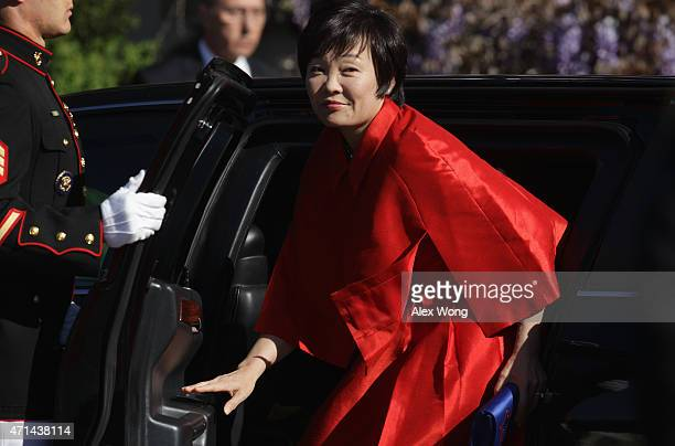 Japanese first lady Akie Abe comes out from a limousine during an official arrival ceremony for her and her husband Japanese Prime Minister Shinzo...