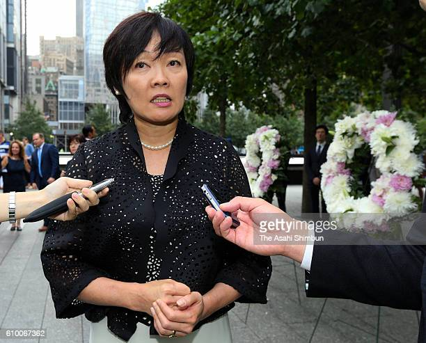Japanese first lady Akie Abe talks to media after offering a wreath at the Ground Zero to commemorate the victims of the 9/11 terror attack on...