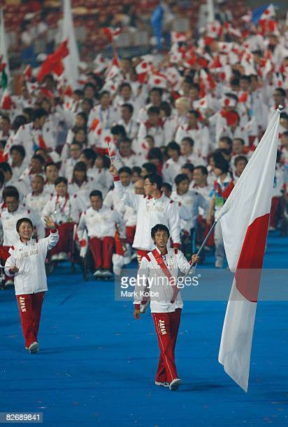 Japanese flag bearer Toru Suzuki leads the team during the entrance of athletes at the Opening Ceremony for the 2008 Paralympic Games at the National...