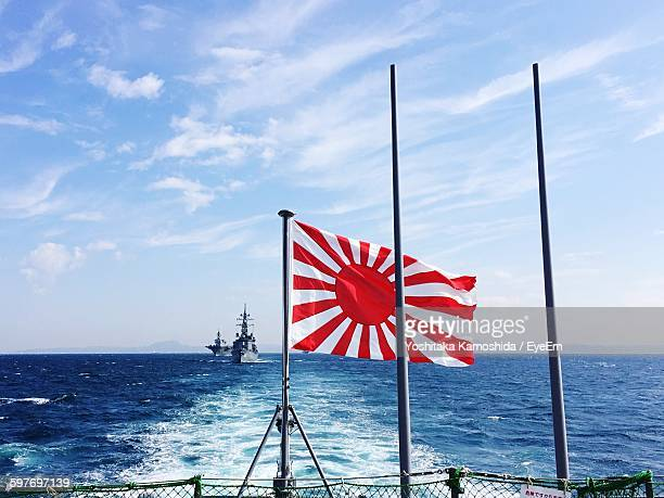 Japanese Flag On Boat At Sea Against Sky