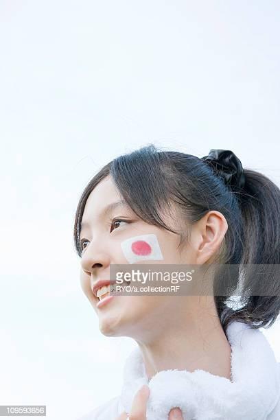 Japanese Flag Painted on Girl's Cheek
