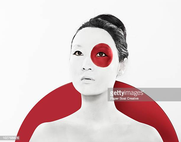 Japanese flag painted on woman's face