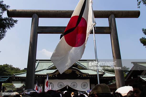 Japanese flag with black mourning ribbon on 15th August, surrender anniversary at the Yasukuni shrine in Tokyo, Japan.