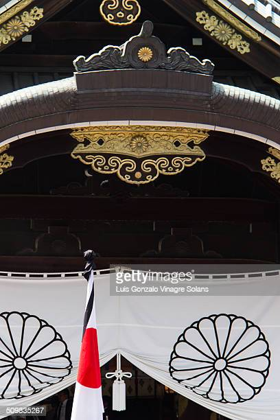 Japanese flag with black mourning ribbon on 15th August, world war 2 surrender anniversary at the Yasukuni shrine in Tokyo, Japan