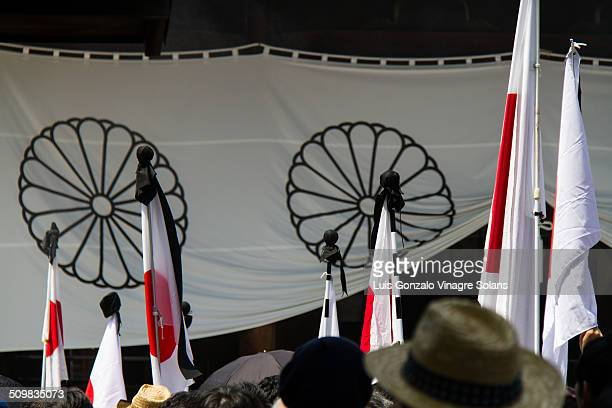 Japanese flags with black mourning ribbons on 15th August, world war 2 surrender anniversary at the Yasukuni shrine in Tokyo, Japan.