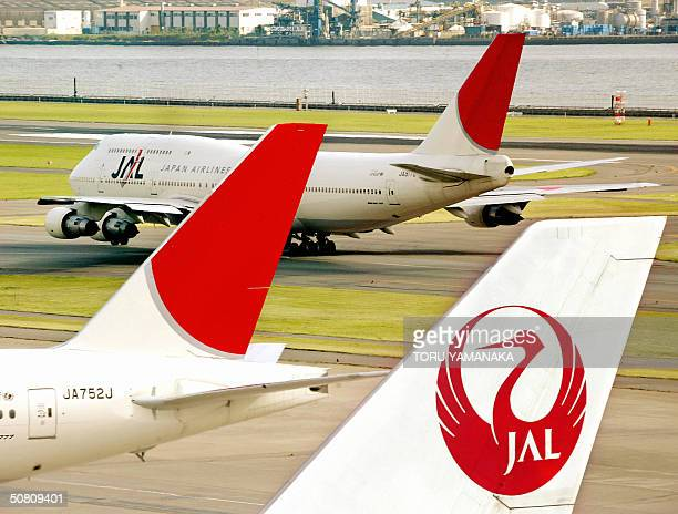 Japanese flagship air carrier Japan Airline System jetliner taxis at the Tokyo International Airport 07 May 2004 JAL posted a huge loss for the year...