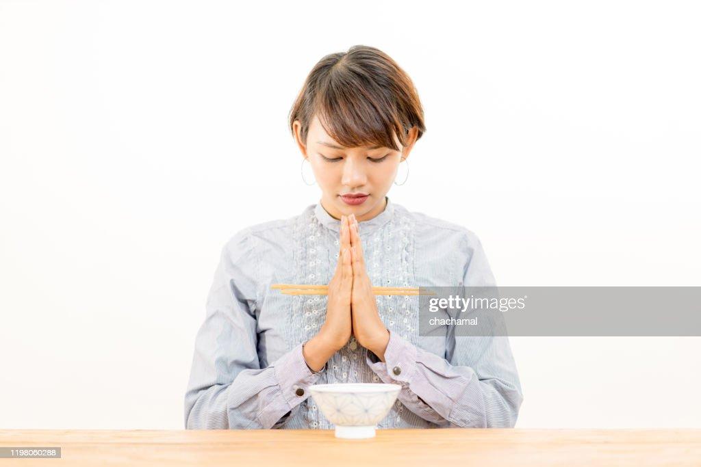 Japanese food, pray, woman : Stock Photo