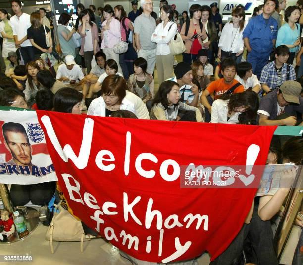 Japanese football fans wait for the arrival of football superstar David Beckham at Narita's New Tokyo International Airport 18 June 2003 Beckham said...